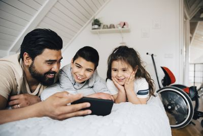 A family watching videos on an Android phone.