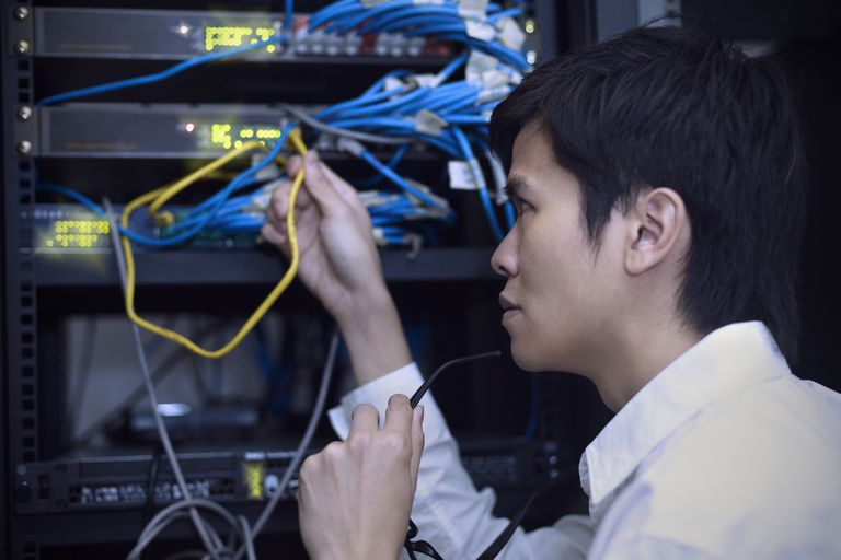 Person inspecting ethernet cables of a server as a Self Service Web Hoster