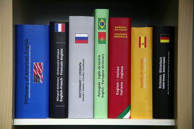 Books of language dictionaries on shelf