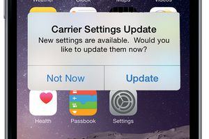 iPhone carrier settings update modal.