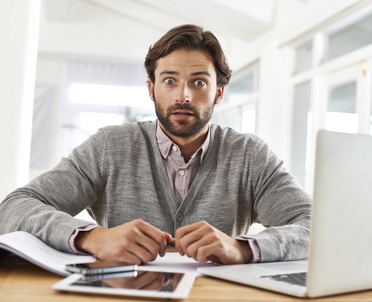 man at computer realizing he made a mistake.