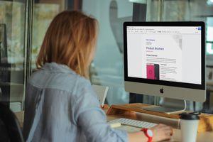 Woman creating brochure in Google Docs.