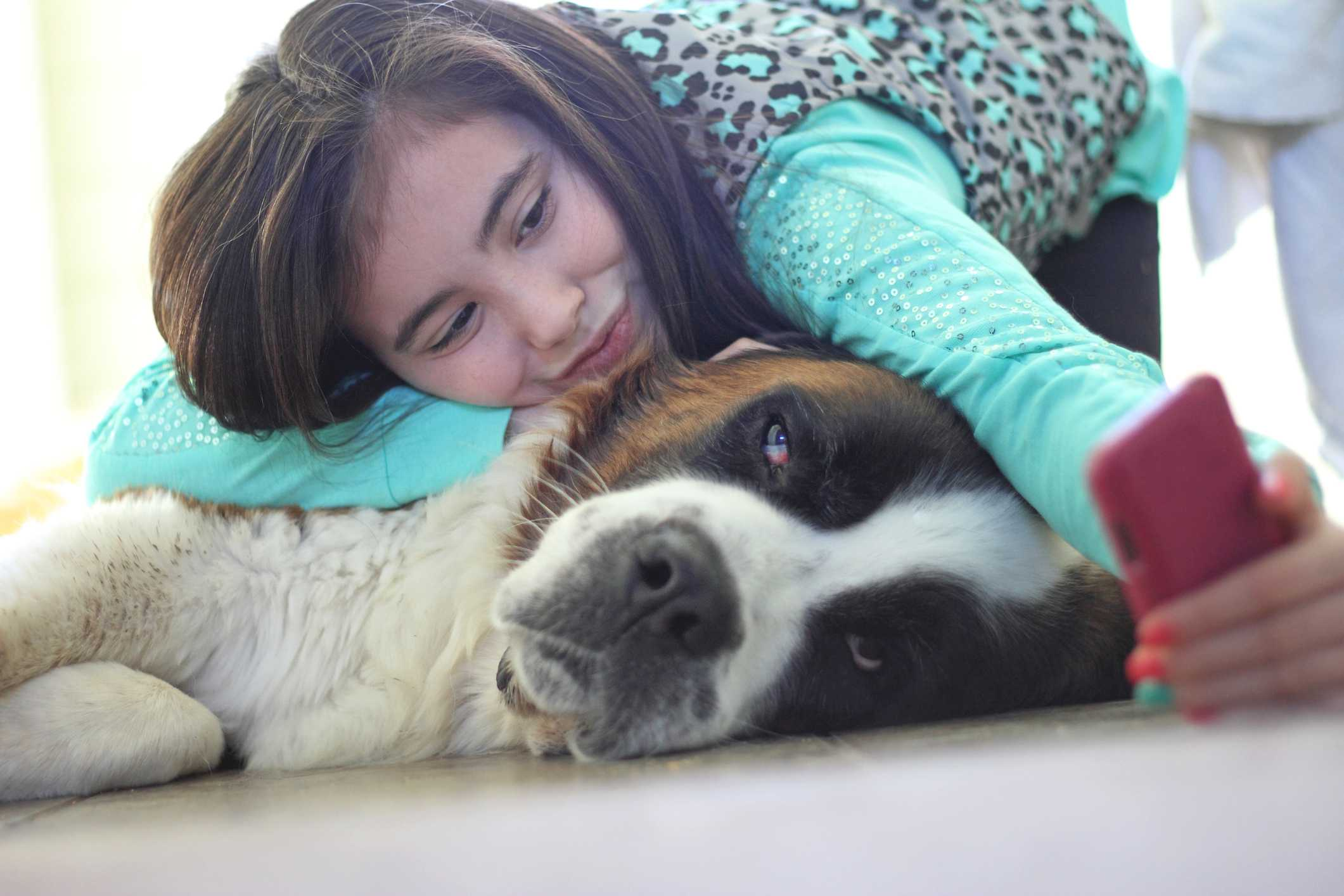 Woman taking a selfie with a large dog