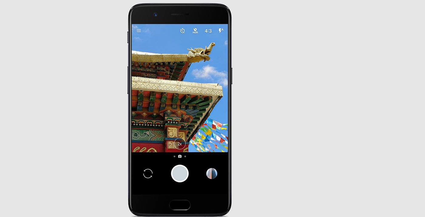 OnePlus 5 smartphone with colorful image on screen