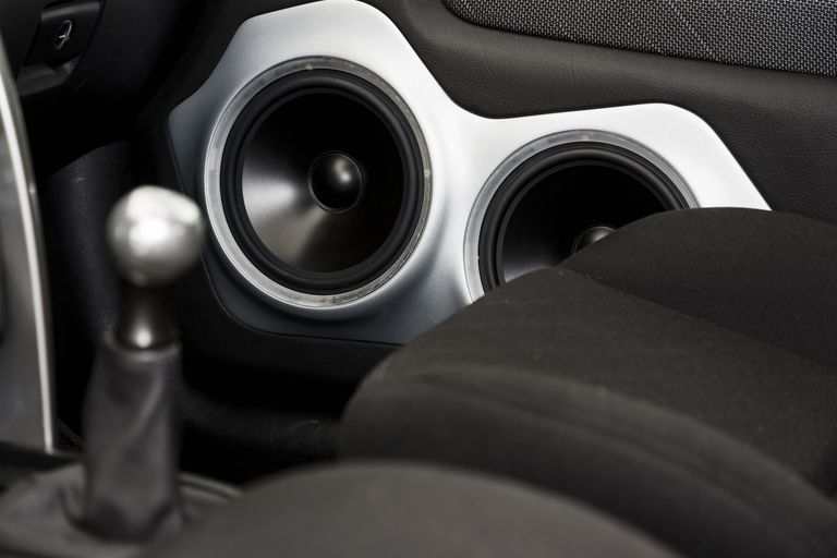 Passenger side speakers in a car
