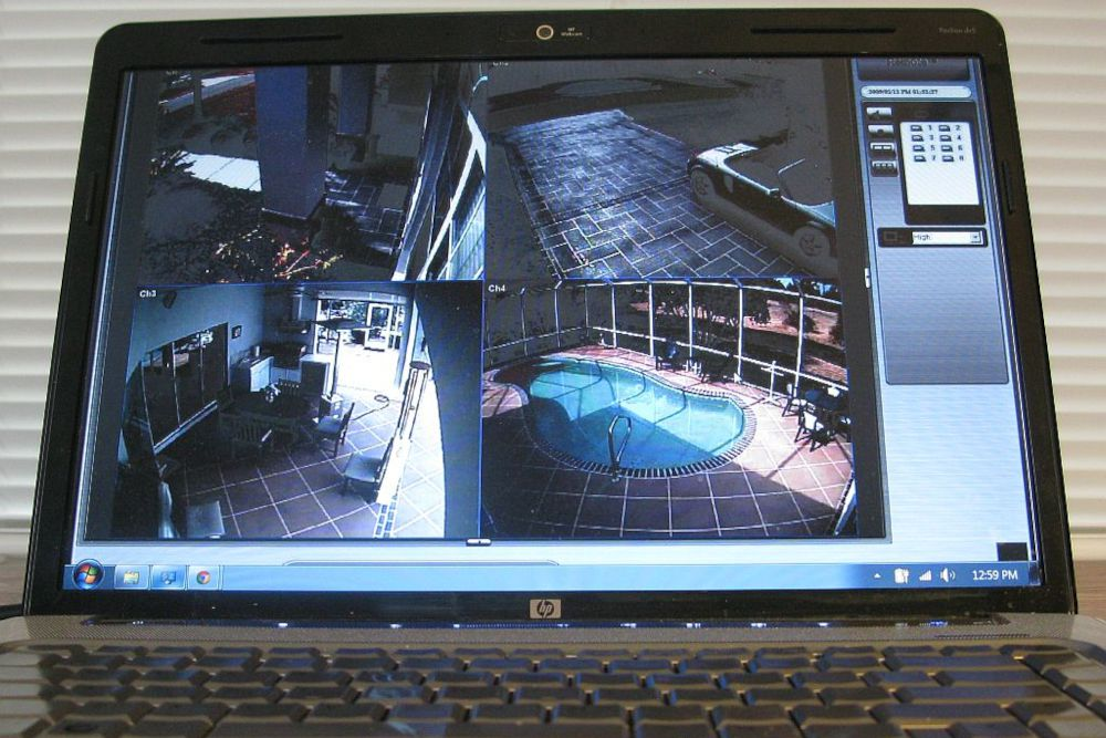 A laptop being used for home security