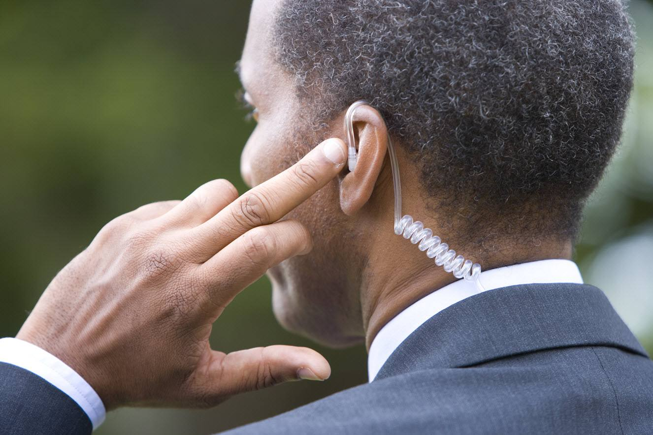 Security agent with earpiece