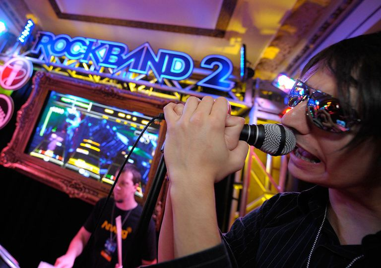 Someone singing on a microphone at Harmonix and MTV Games' Rock Band Party