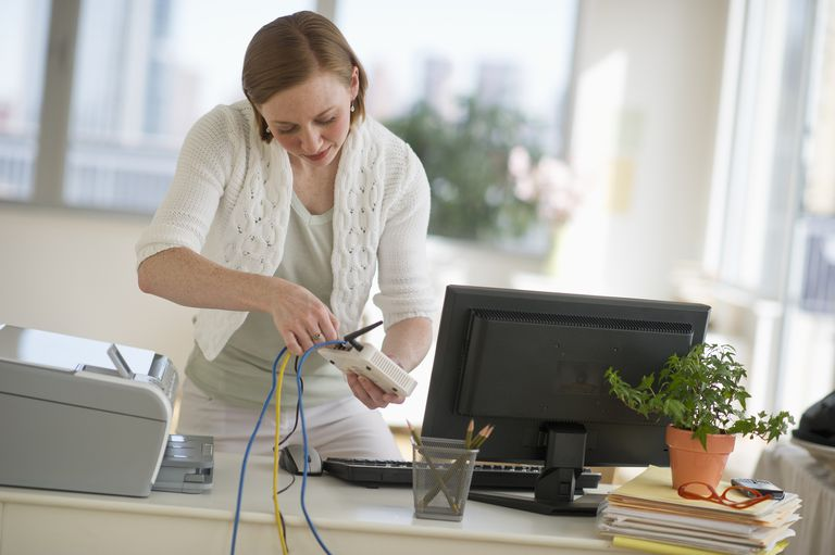 Woman plugging in router