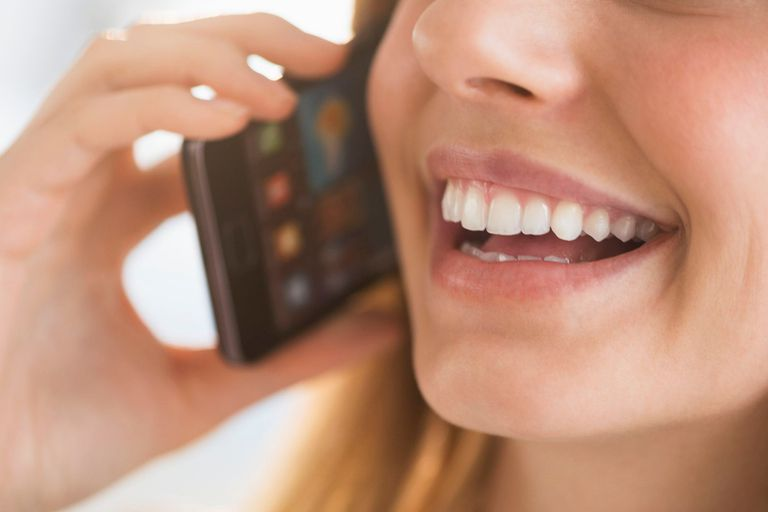 Woman talking on cell phone closeup