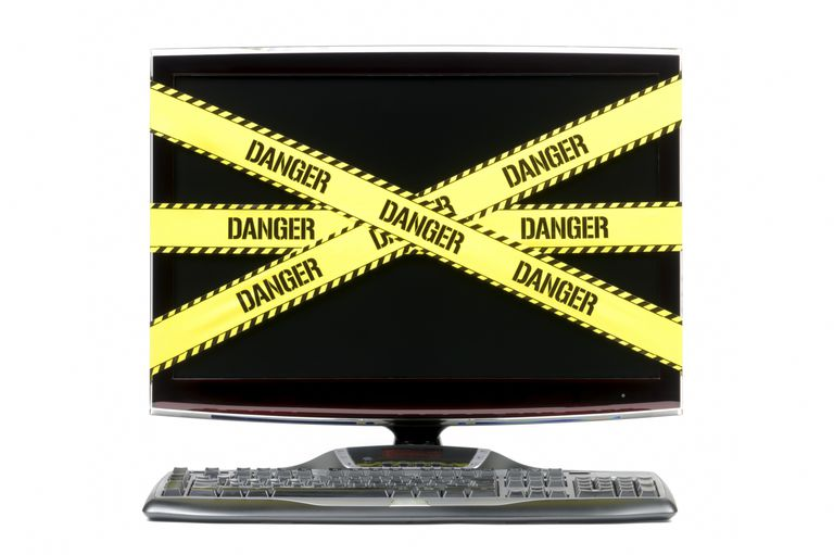 Photo of a computer monitor covered in DANGER tape