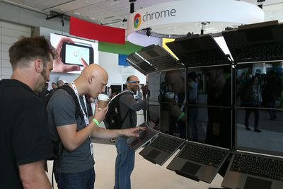 Attendees inspect a display of Google Chromebook Pixel laptops during the Google I/O developers conference at the Moscone Center on May 15, 2013 in San Francisco, California.