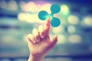 Ripple cryptocurrency logo and hand