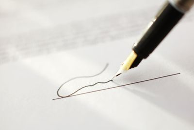 Pen writing a signature