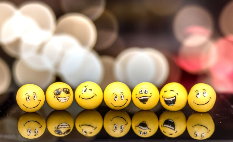 Various emoji faces on a table