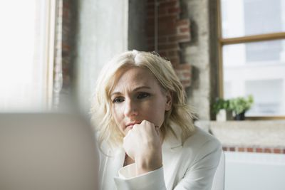 Serious businesswoman on computer