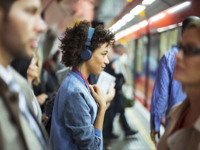 Woman with headphones in subway