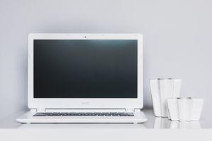 A laptop computer on a desktop.