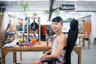 Person in 3D printing workspace