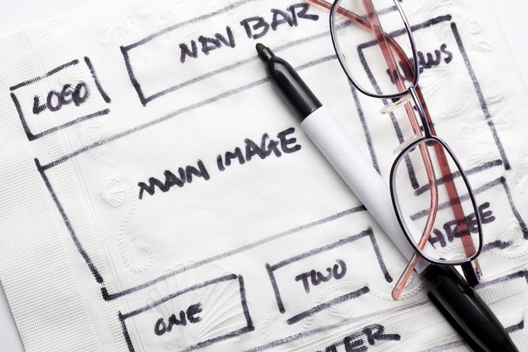 Mapping out a website layout with a marker and a napkin