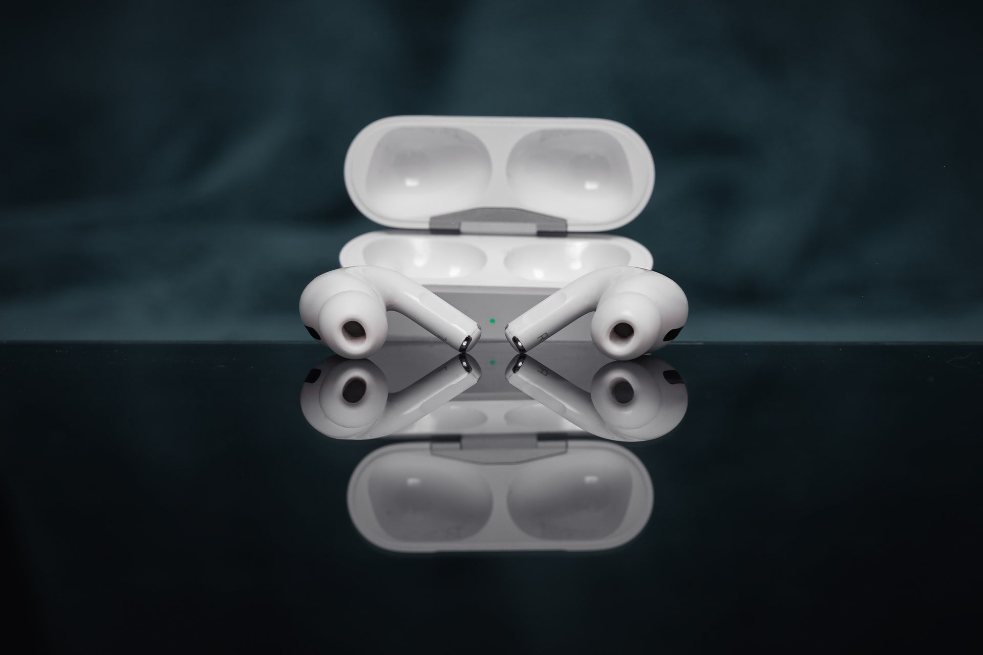 Apple AirPods Pro on a reflective surface