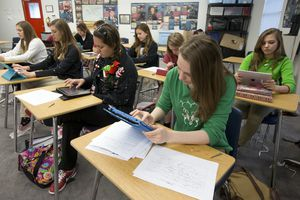Apple iPads in high school classroom.