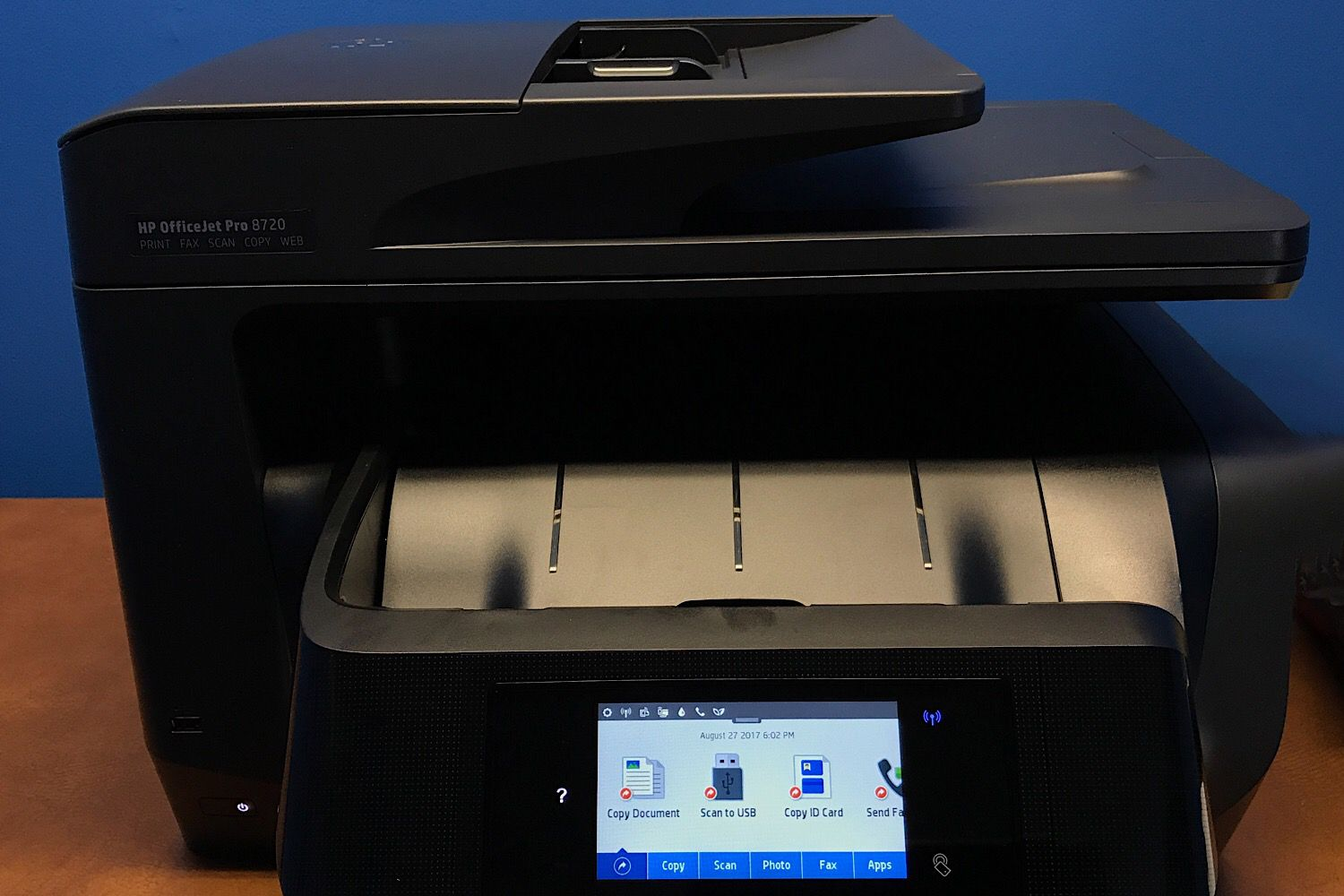 An HP OfficeJet Pro 8710 with control panel active -- and WiFi enabled (upper right area of control panel)