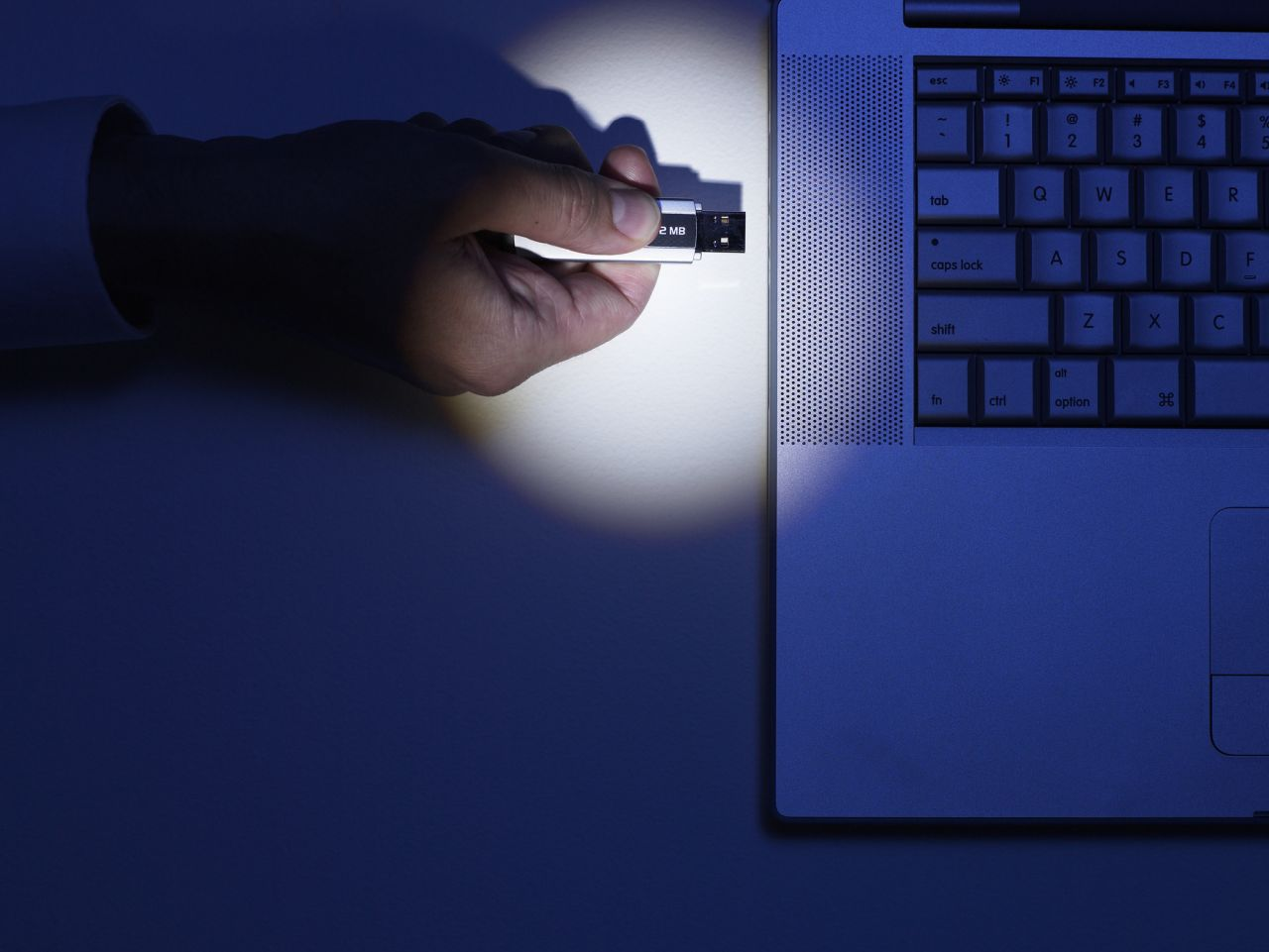 Image of using a thumb drive on a laptop