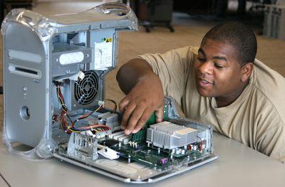 Man adding RAM to a PC