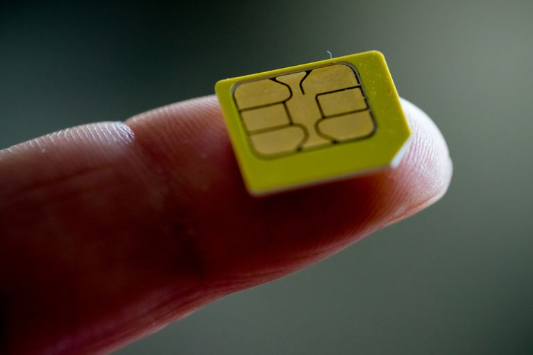 Close up of SIM card on finger