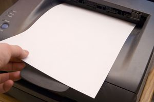 Feeding paper into a printer