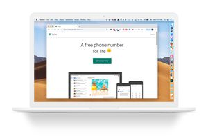 White MacBook with Google Voice web page onscreen
