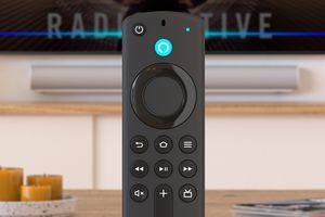 Amazon Firestick in front of a TV playing Paramount Plus app.