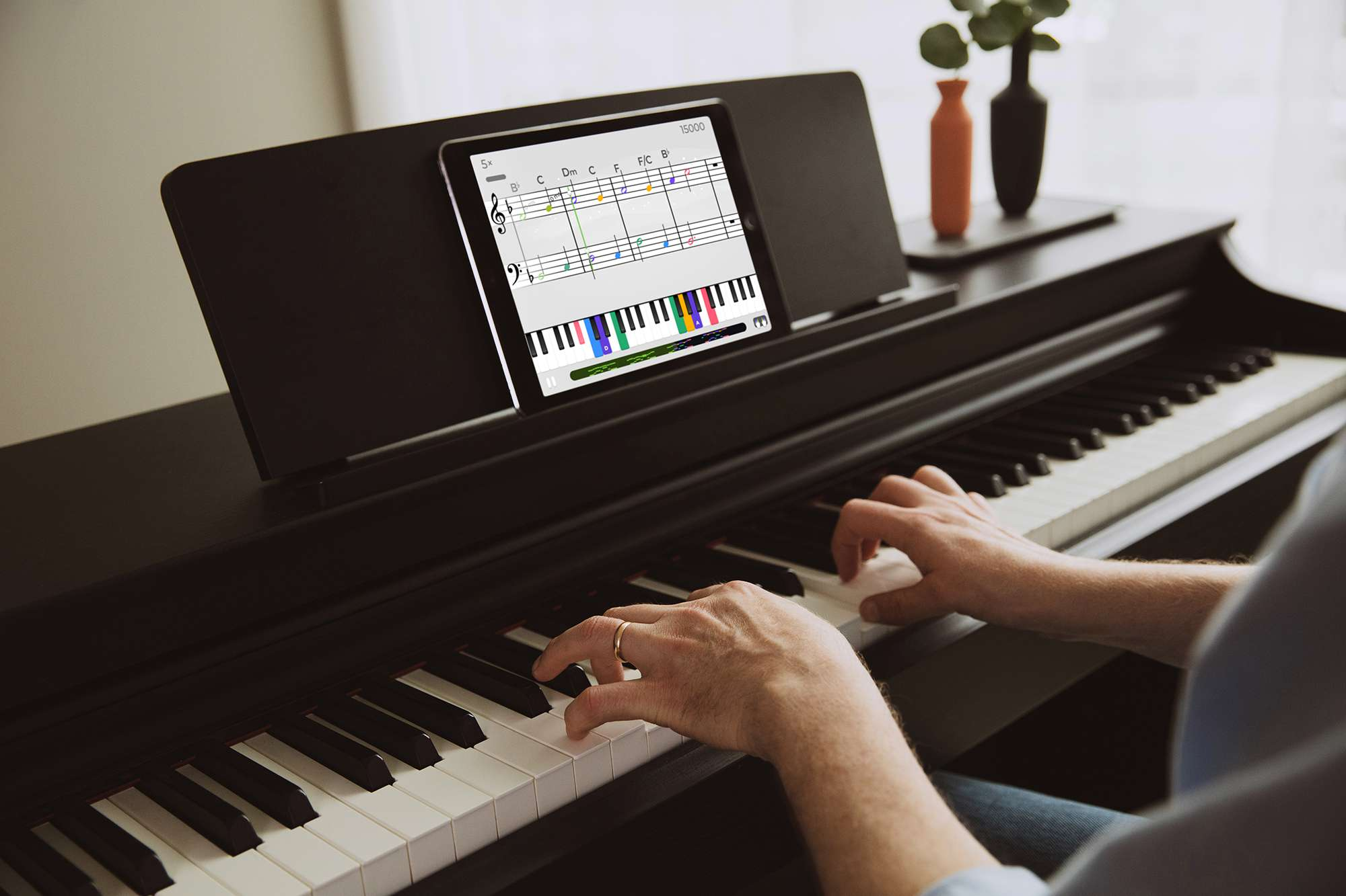 A person learns piano with Yousician on iPad
