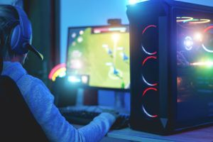 A gamer playing a strategy game on a computer.