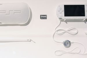 PSP with case and headphones at Tokyo Game Show 2005