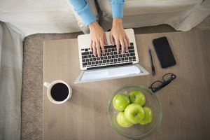Top view of woman working on laptop