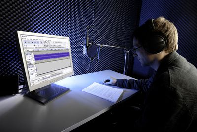 A man records a podcast with Audacity.