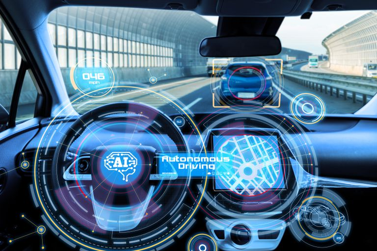 An autonomous car drives on a highway without any driver input.