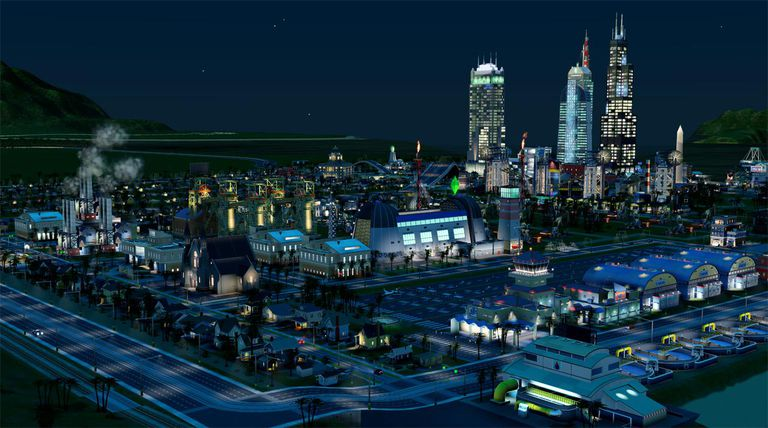 Lit-up nighttime view of a town in City 2