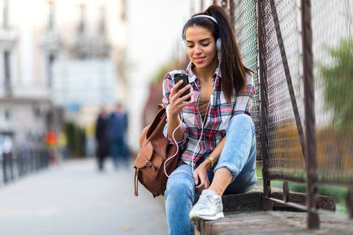 Girl listening to android music app