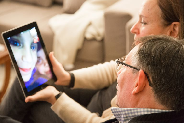 Two people using FaceTime on an iPad