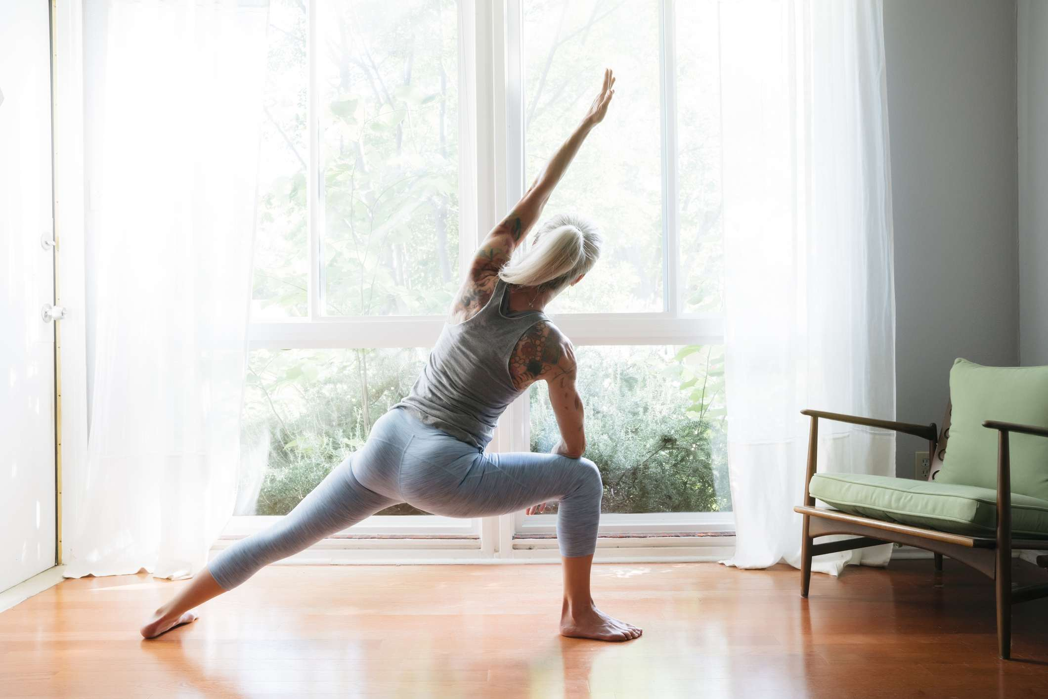 Person doing yoga in living room
