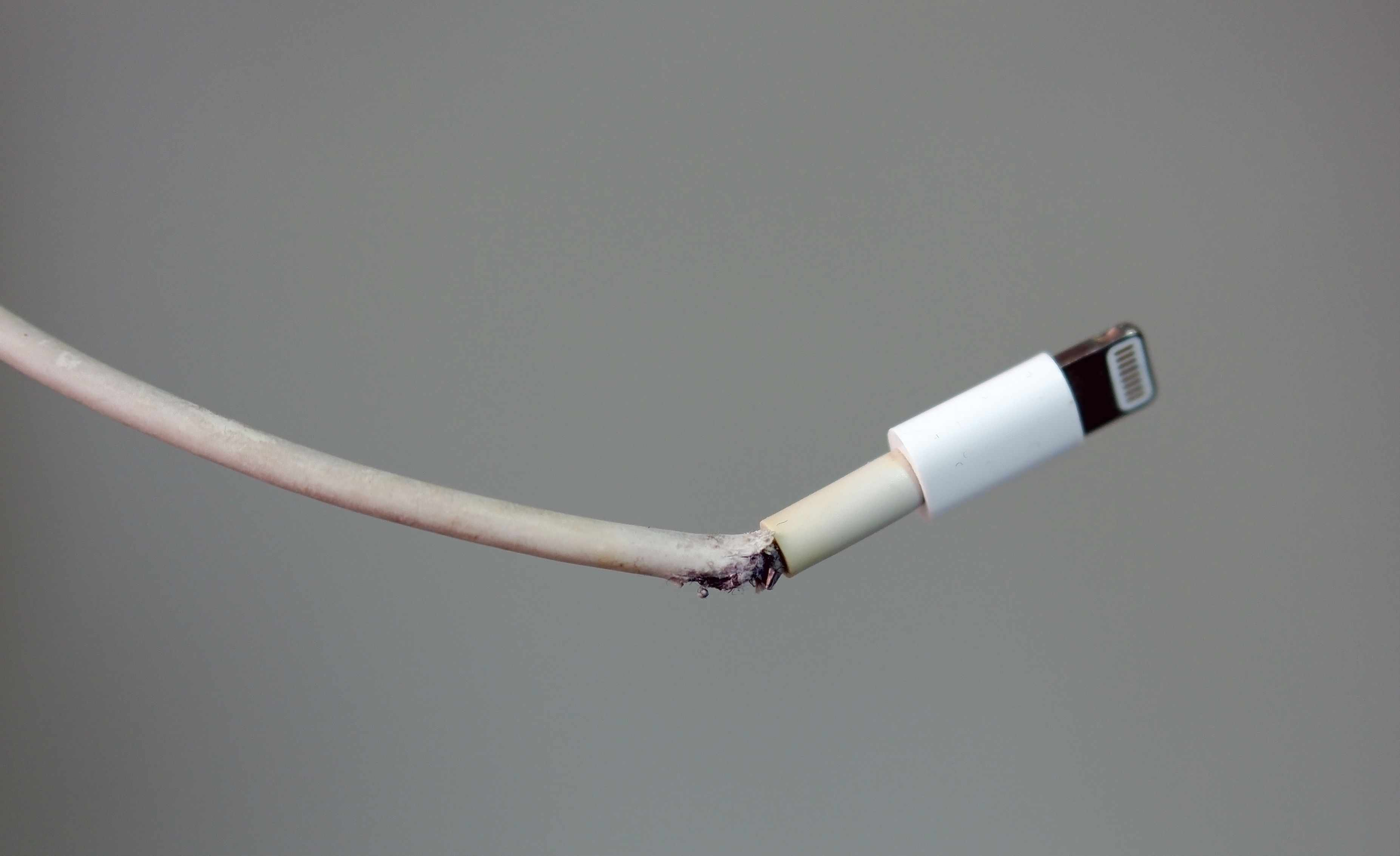 A damaged Lightning cable that may catch fire.