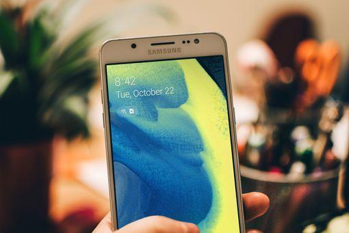 Someone holding a Samsung Galaxy smartphone.