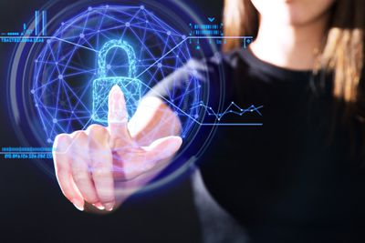 Person's finger touching a transparent lock representing electronic privacy