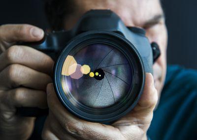 Man pointing camera at camera