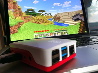 Raspberry Pi case in front of a Minecraft screen on a MacBook Pro