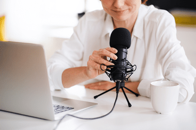 Image of a woman talking into a computer microphone