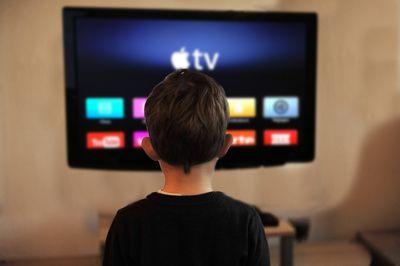 A boy watching Apple TV